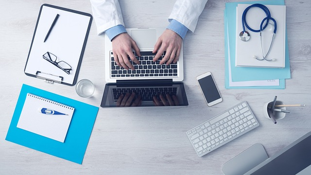doctor typing at computer